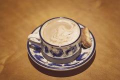 Koffie en biscotti Stock Afbeelding
