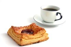 Koffie en een broodje stock foto