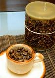 Koffie en kaars Stock Foto