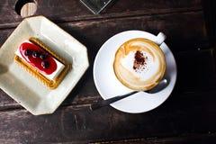 Koffie en kaastaart Stock Fotografie
