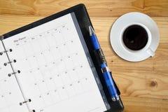 Koffie en notitieboekje Stock Foto's