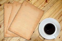 Koffie en notitieboekje Stock Foto