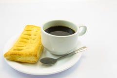Koffie en pastei Stock Foto's