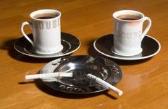 Koffie en sigaretten Stock Foto