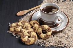 Koffie en smakelijke koekjes royalty-vrije stock foto's