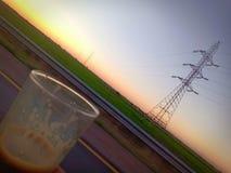 Koffie en zonsondergang royalty-vrije stock foto's