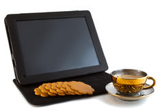 Koffie, koekjes en tablet Stock Foto