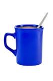 Koffie met melk in een blauwe kom Stock Fotografie