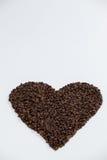 Koffiebonen die gevormd hart vormen Stock Afbeeldingen