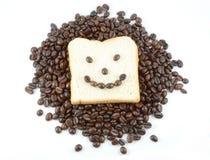 Koffiebonen en brood het glimlachen Stock Foto