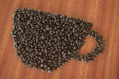 Koffieboon als kop op houten lijst Royalty-vrije Stock Foto