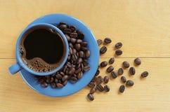 Koffiekop en bonen stock foto's