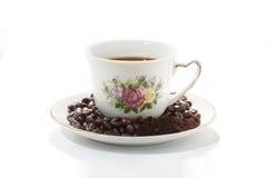 Koffiekop en bonen Stock Foto