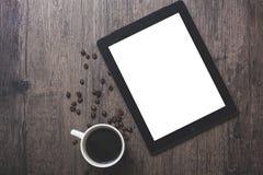 Koffiekop en Ipad Stock Afbeeldingen
