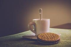 Koffiekop en koekjes Stock Foto