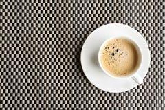 Koffiekop op de plaatmat Royalty-vrije Stock Afbeelding