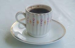 Koffiekop op een schotel Stock Foto's