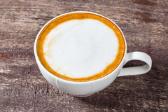 Koffiekop op oude houten lijst Royalty-vrije Stock Afbeelding
