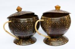 Koffiekop van kokosnoten dieshell wordt gemaakt Stock Afbeelding
