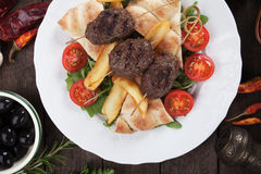 Kofta kebab with french fries and flatbread Stock Images