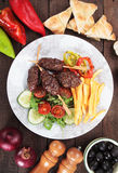 Kofta kebab with french fries nad salad Stock Images