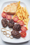 Kofta kebab with french fries and pita bread. Kofta kebab, oriental minced meat kebab with pita bread and french fries Royalty Free Stock Image
