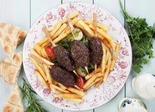 Kofta kebab with french fries Stock Photo