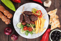 Kofta kebab with french fries Royalty Free Stock Images
