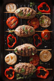 Kofta kebab with grilled vegetables on grill close-up. vertical Stock Photo