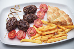 Kofta kebab, minced meat skewer. With pita bread and french fries Royalty Free Stock Photography