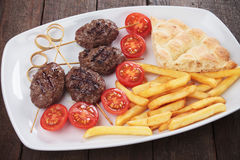 Kofta kebab with pita bread and french fries Stock Image