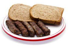 Kofta roasted with toast bread on plate. And on white background Royalty Free Stock Images
