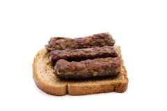 Kofta roasted on toast bread. And on white background Royalty Free Stock Photos
