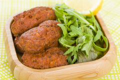 Koftas. Asian style meatballs served with salad Royalty Free Stock Images