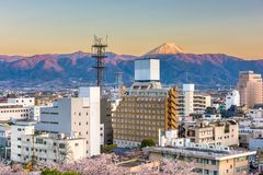 Kofu, Japan city skyline with Mt. Fuji stock photo