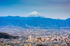 Kofu Japan med Mt fuji royaltyfri foto