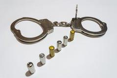 Kogels en handcuffs Royalty-vrije Stock Afbeeldingen