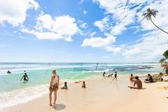 Koggala Beach, Sri Lanka - DECEMBER 2015 - Natives and tourists. Koggala Beach, Sri Lanka, Asia - DECEMBER 2015 - Natives and tourists relaxing at Koggala Beach Royalty Free Stock Photos
