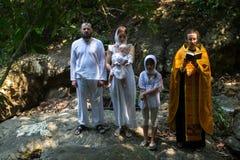 During Baptism - Christian sacrament of spiritual birth Stock Photo