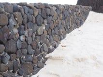 Wall on beach stock photo