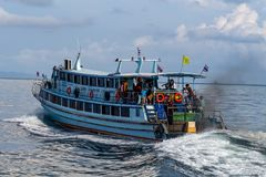 Motorboat to Koh Phi Phi island Thailand. Koh Lanta, Thailand - May 7, 2018: Passengers on a motorboat navigating in the Andaman Sea and directed to Koh Phi Phi royalty free stock image