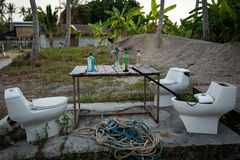 Koh Lipe, Thailand - February 20, 2019: Improvised bar with toilet seats and alkohol on table. stock image