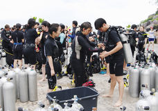 KOH NANGUAN, THAILAND -  OCTOBER 22, 2013: Equipment for scuba diving and team of divers Stock Image