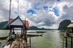 Koh Panyee settlement built on stilts of Phang Nga Bay, Thailand. Canoeing at Koh Hong IslandPhang-Nga, Thailand Thailand 21 MAY 2017 : Koh Panyee settlement Royalty Free Stock Images