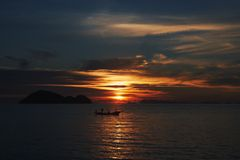 Koh Phangan island, Thailand. Sunset on the sea. Fisherman in a boat stock photography