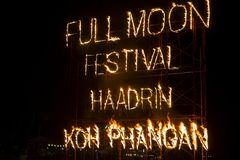 Full Moon Party fire sign on Haad Rin beach in island Koh Phangan, Thailand. KOH PHANGAN, THAILAND - MARCH 02, 2018 : Full Moon Party fire sign on Haad Rin beach royalty free stock photos