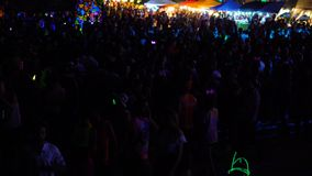 KOH PHANGAN,THAILAND - NOVEMBER 16, 2016 : Unidentified girls and boys dancing the Full Moon party in island Koh Phangan. The event now attracts anywhere from stock footage