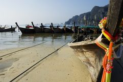 Koh Phi Phi, long-tails boats and colored ribbons Royalty Free Stock Photography