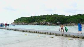 Tourists departure from Raya Island. KOH RACHA YAI, THAILAND - NOVEMBER 20, 2017: Tourists walking on grey pontoon oboard speedboat at Koh Racha Yai Island stock footage