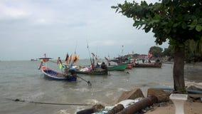 KOH SAMUI island, THAILAND - December 19, 2017: fishing wooden boats swaying on the waves. Koh Samui island stock video footage